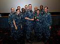 150902-N-OT964-204 Mike Stevens takes photo with sailors.jpg
