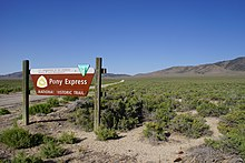 Pony Express road sign in a desert setting with sage brush