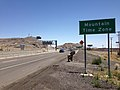 2014-07-05 12 40 49 Sign for the Mountain Time Zone along Interstate 80 eastbound just west of the Utah border in West Wendover, Nevada.JPG