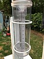 2018-06-28 20 30 19 A 4-inch plastic CoCoRaHS rain gauge with exactly 1 inch of rain water along Terrace Boulevard in Ewing Township, Mercer County, New Jersey.jpg