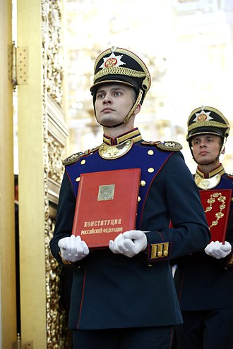 Fourth inauguration of Vladimir Putin - Soldiers of the Kremlin Regiment make the Constitution of Russia and the chain of office.