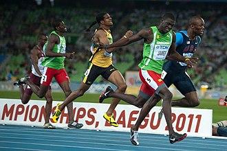 Rondell Bartholomew - Bartholomew (left in green) running in the 2011 World Championship final