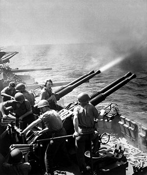 USS Hornet (CV-12) - 40 mm guns firing aboard Hornet on 16 February 1945, as the carrier's planes were raiding Tokyo.