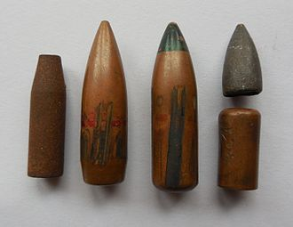 7.62×39mm - From left to right: steel core, 57-N-231 standard AK military bullet with steel core, green tipped 57-N-231P tracer, the tracer cup (open at the bottom, made from copper washed steel) and lead tip. The jackets of both bullets are copper washed steel.