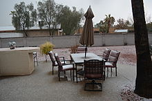 photo of graupel covered lawn furniture in a suburban backyard