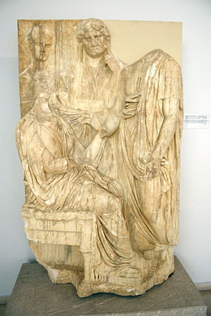 Women's medicine in antiquity - Greek Attic funerary stele, showing a seated woman who died in childbirth bidding farewell to her husband, mother and newborn's nurse. Around 350 to 330 BCE.