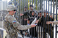 82nd Airborne Division medic hands out toys to Afghan children DVIDS483323.jpg