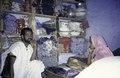 ASC Leiden - van Achterberg Collection - 1 - 163 - Le magasin d'un commerçant mauritanien. Homme derrière le comptoir d'un magasin avec de la nourriture - Dori, Burkina Faso - 9-29 novembre 1996.tiff