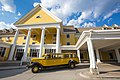 A Yellow Bus waiting for passengers outside of the Lake Yellowstone Hote (2ed03628-f9a5-4ee9-8893-d4c9b22fa7da).jpg