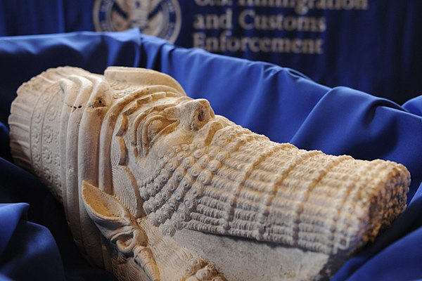 A limestone statue depicting the head of the Assyrian King Sargon II, illegally smuggled into the United States.jpg