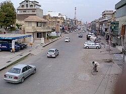 Clockwise from top: Major Akram Shaheed Memorial, Tareekh-e-Jhelum book cover, Cantonment Square, CMH Mosque và Zamir Jaffri Cricket Stadium
