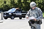 Air Force Tech Sergeant consults blueprints during August 2 2017 training exercise.jpg