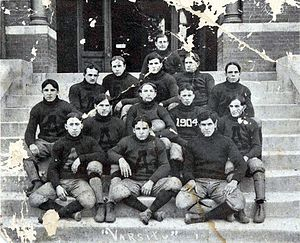 "1904 Auburn Tigers football team - The 1904 football team of the Alabama Polytechnic Institute (now Auburn University). Coach Mike Donahue is in the second row with ""1904"" on his jersey."