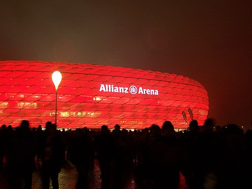 Allianz Arena at night, lit in red