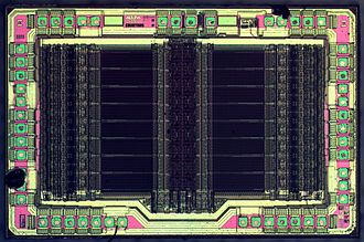 Complex programmable logic device - Die of an Altera EPM7032 EEPROM-based Complex Programmable Logic Device (CPLD). Die size 3446x2252 µm. Technology node 1 µm.