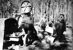 Camp Cable - American soldiers using a stationary engine at Camp Cable, Queensland ca. 1942
