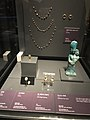 Amulet, Scarab, bell-shaped earrings, statuette of Isis-Tyche, ornaments at National Museum of Korea.jpg
