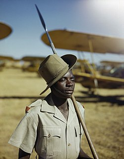 An African soldier or 'Askari' on guard duty at No. 23 Air School at Waterkloof, Pretoria, South Africa, January 1943. TR1262