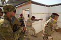 An Australian soldier assigned to Task Group Taji watches as Iraqi soldiers assigned to the 23rd Iraqi Army Brigade clear a room without weapons.jpg