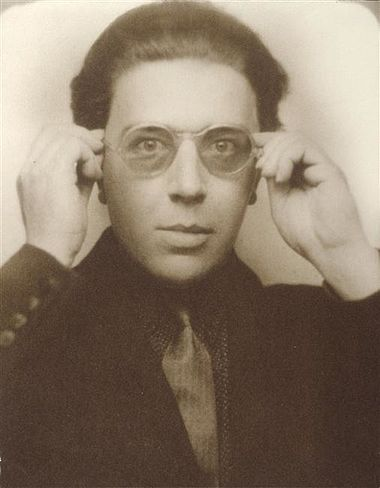 "Andre Breton 1924 Breton defined Surrealism as: ""Pure psychic automatism through which it is intended to express, either orally or in writing, or in any other way, the actual way thought works."" Andre Breton 1924.jpg"