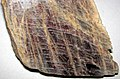 Anorthoclase feldspar with iridescent hematite inclusions (Potanikha Quarry, Kasli, Ural Mountains, Russia) 1 (29477383824).jpg