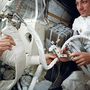 "Jack Swigert - Swigert, at right, with the ""mailbox"" rig improvised to adapt the Apollo 13 Command Module's square carbon dioxide scrubber cartridges to fit the Lunar Module, which took a round cartridge"
