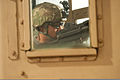 Army Capt. John Moore, a civil affairs officer with Provincial Reconstruction Team Kapisa, mans the turret of a simulated armored vehicle while training to respond to improvised explosive device (IED) attacks 111216-A-PX072-151.jpg