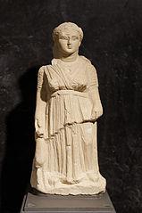 Artemis holding a doe