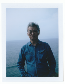 Artist Nobuo Sekine facing away from the Pacific Ocean, ca. 2014.tiff