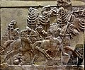 Assyrian horse riders hunting in a forest, from Khorsabad, Iraq. The Iraq Museum.jpg