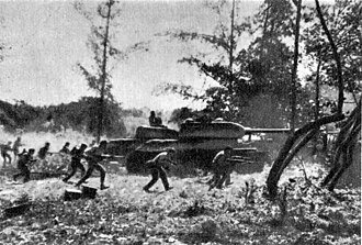 Bay of Pigs Invasion - Cuban soldiers supported by T-34 tanks attacking near Playa Giron. April 19, 1961