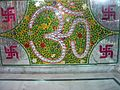 Aum symbol surrounded by swastikas in a temple, Amritsar Punjab India.jpg