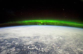 Aurora - ISS Expedition 6 team, Lake Manicouagan is visible to the bottom left
