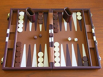 A backgammon set, with two dice cups and a dou...