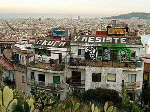 "Satiric misspelling - Barcelona squat and anarchist centre, labelled ""OKUPA Y RESISTE"""