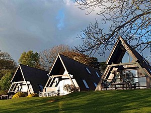 Timeshare - Barnsdale Hall Hotel (UK) timeshare lodges. On the grounds of the Best Western Hotel are a number of timber A-frame chalets.