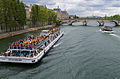 Bateau Mouche and Pont Royal, Paris 12 June 2015.jpg