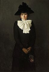 Portrait of a young woman holding a rose (Portrait of M-lle R.).