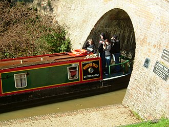 Stoke Bruerne - Narrowboat emerging from the south portal of the Blisworth Tunnel just north of Stoke Bruerne