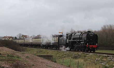 A steam locomotive and carriages, on the West Somerset Railway, a heritage line of notable length, in spring 2015 Blue Anchor - 70021 (aka 70000) down South Wales Pullman.JPG