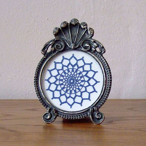 Blue arlington fancy doily in round pewter frame