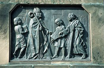 Boniface builds a church, relief on the base of the statue of St. Boniface by Werner Henschel (1830) in Fulda (detail)
