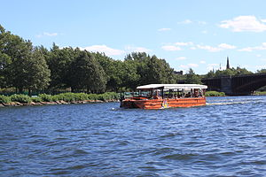 A Boston Duck Boat tour boat in the Charles River