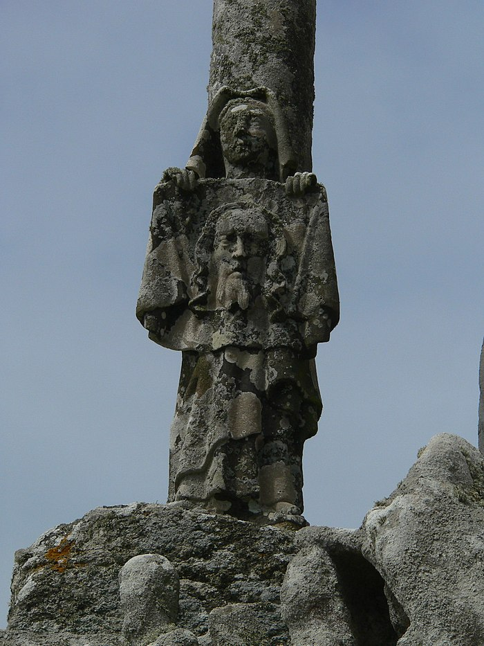 Saint Veronica holds out her veil now bearing Jesus' image. Part of the Calvaire de Tronoēn