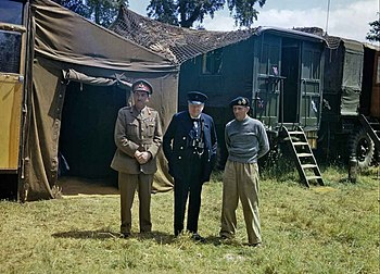 Brooke (on the left) and Churchill visit Montgomery's mobile headquarters in Normandy, 12 June 1944.