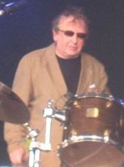 Bruce Mitchell sitting at the drums