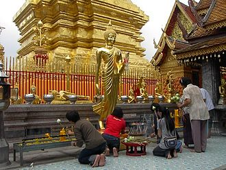 Iconography of Gautama Buddha in Laos and Thailand - Buddhists venerating a Leela Buddha image (Wat Doi Suthep, Chiang Mai, Thailand)