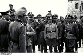 August Schmidhuber - August Schmidhuber (far right, in front) and other SS officers on tour of Mauthausen-Gusen concentration camp, April 1941