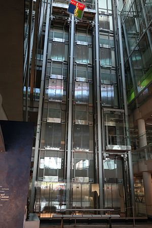 Burton Barr Central Library - Vertical circulation core containing three high-speed elevators