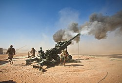 Charlie Battery, 1st Battalion, 12th Marine Regiment, fire an M982 Excalibur round from an M777 howitzer (2).jpg